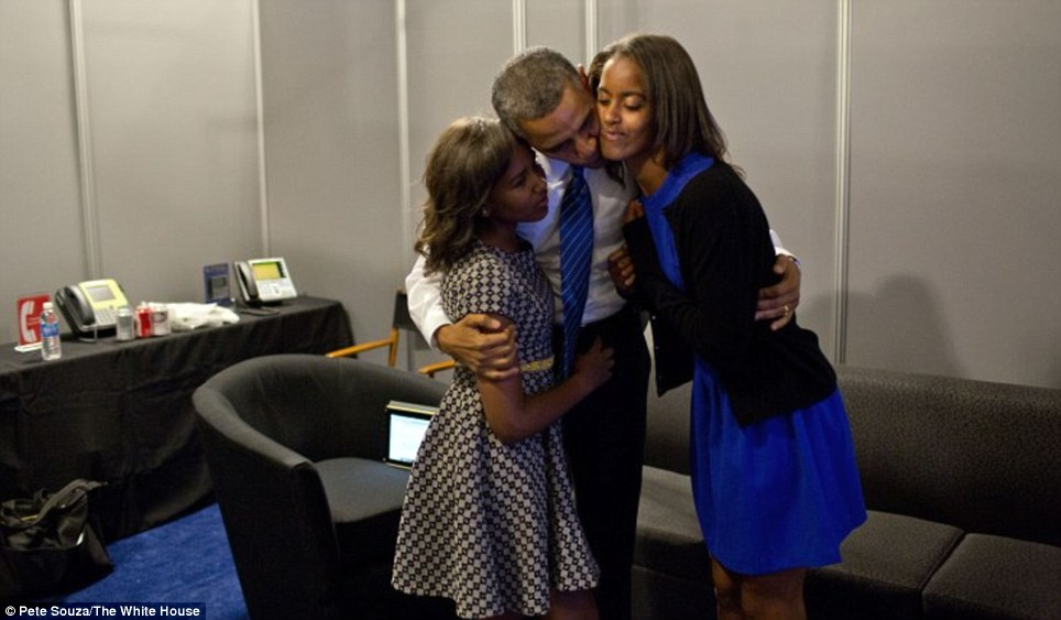 Father: President Obama greets daughters Sasha and Malia at the Time Warner Cable Arena before delivering remarks at the Democratic National Convention in Charlotte