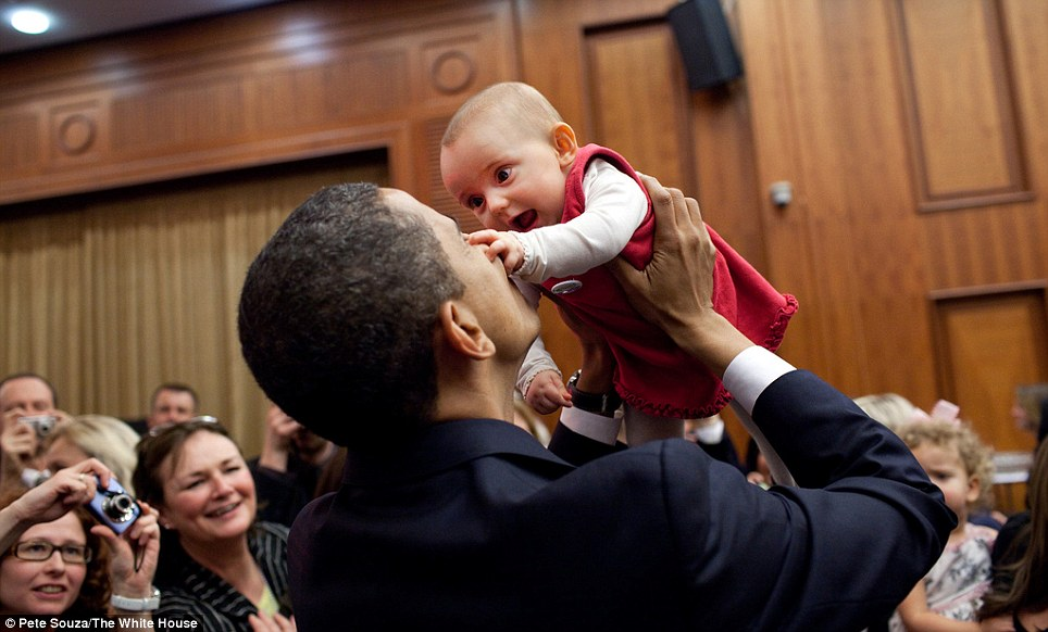 President Obama lifts up a baby on April 4, 2009, during the U.S. Embassy greeting at a Prague hotel