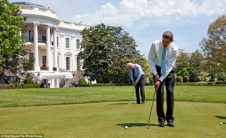 Golfing Buddies: President Barack Obama and Vice President Joe Biden practice their putting on the White House putting green April 24, 2009