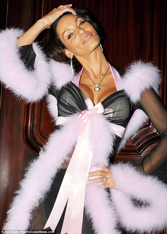 Looking good: The ex wife of Eddie Murphy certainly didn't look her 44 years in the pink and black fur lined get up