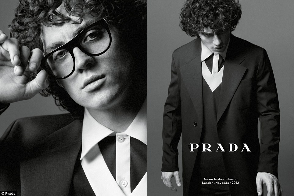Simplicity: Aaron Taylor-Johnson layers up in Prada for the new campaign, sporting an shirt, sweater and long summer coat