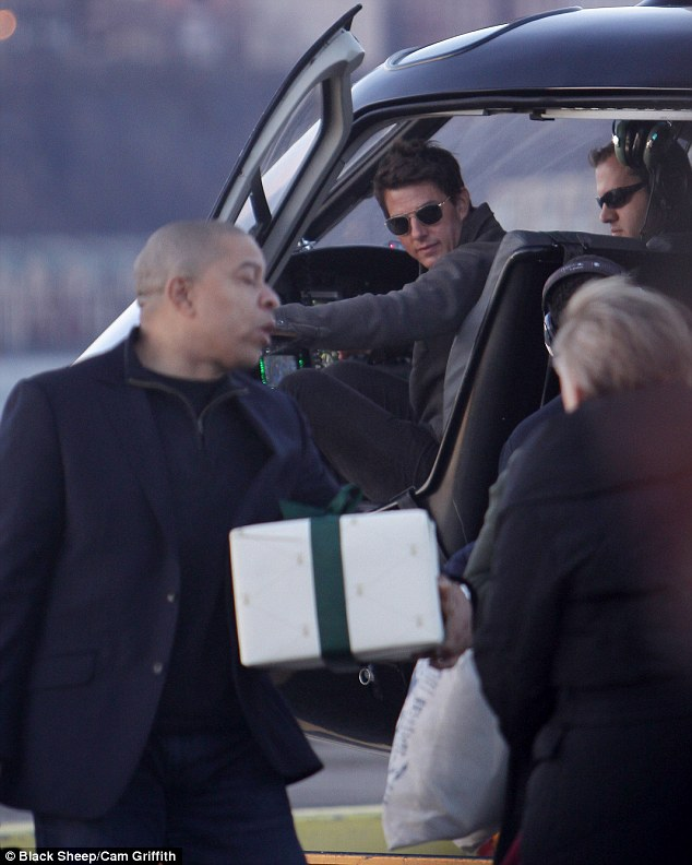 Nice ride, dad: There's no such thing as commercial flights if you're Tom Cruise, as he was spotted with his son jumping on a helicopter in New York
