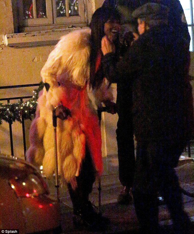 Good spirits: Naomi shares a laugh with a friend outside the restaurant