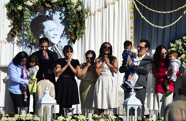 Prayers: The late Ravi Shankar's family, including daughter Norah Jones (4thL in black), wife Sukanya (5thL) and Anushka (6thL) offer a gesture in appreciation and thanks to those in attendance