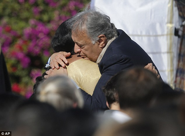 Condolences: Shankar's wife Sukanya Rajan, left, is comforted by conductor Zubin Mehta