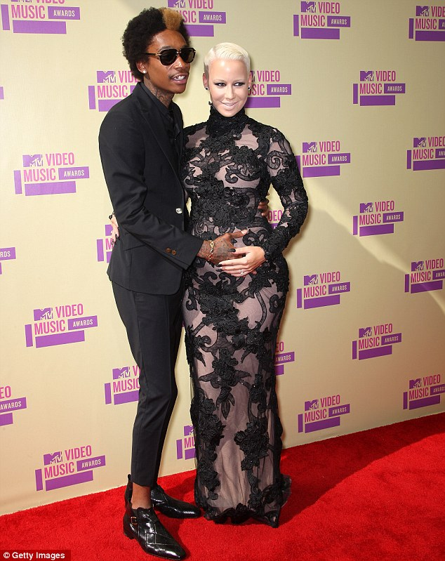 No secret: Amber Rose and Wiz Khalifa aren't planning to hide his love of pot but simply teach their boy that he's not to do partake as a youngster