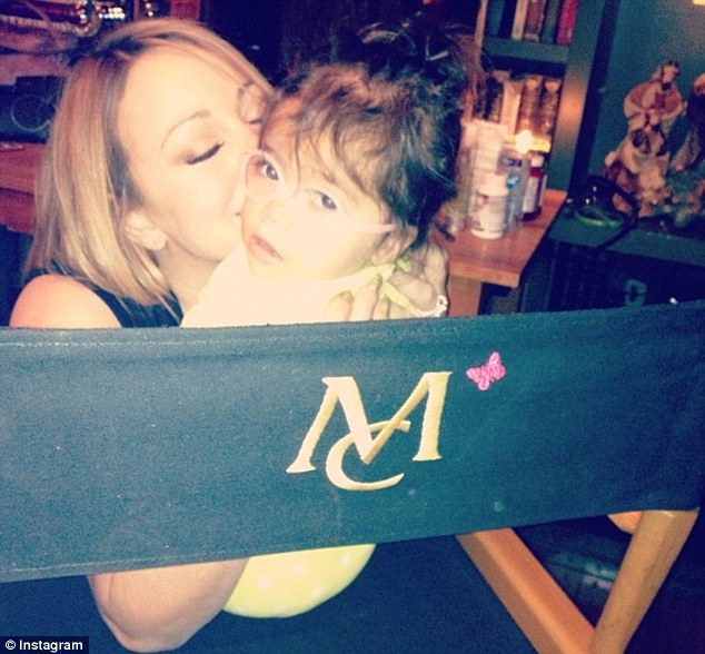 So cute: Mariah plants a kiss on her daughter Monroe's cheek and posted the snap on Instagram