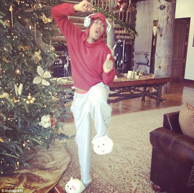 Larking about: Husband Nick Cannon shows off his new lamb slippers