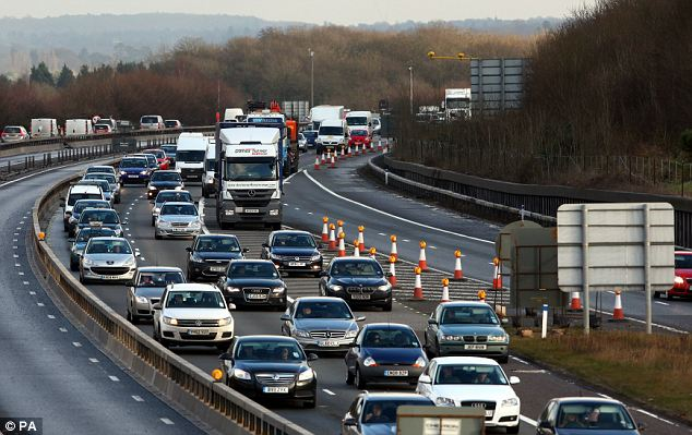 Choked: The M25 near Westerham in Kent had a queue at lunchtime as people streamed away in their cars today