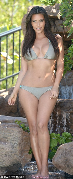 Different style: Kim switches to a slightly chunkier green bikini, making the most of her figure