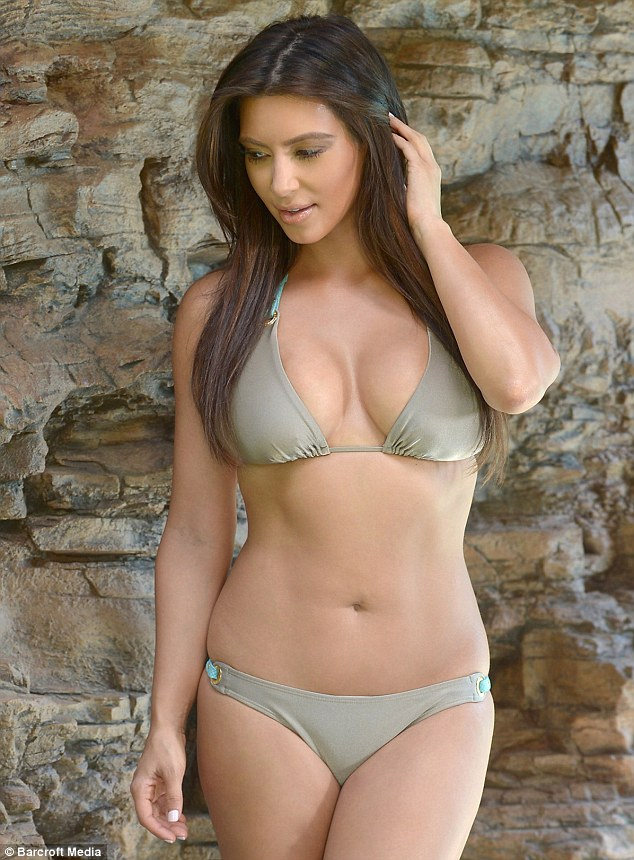 Immaculate: The buxom beauty looked styled to perfection as her dark hair falls poker straight over her shoulders
