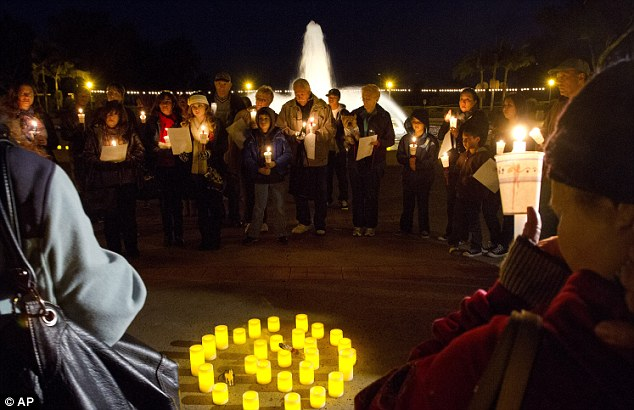 Coming together: People attend a candlelight vigil honoring victims of the Sandy Hook Elementary School