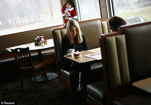 Respect: Diners at the Blue Colony diner remembered the victims of the Sandy Hook at 9.30am