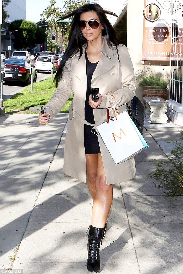 Hair today: Kim Kardashian had a busy Friday morning, visiting two salons in Beverly HIlls just one day after getting her hair done