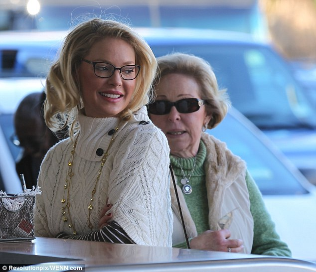 Good genes: Katherine and her mother Nancy Heigl were wearing matching beige gilets