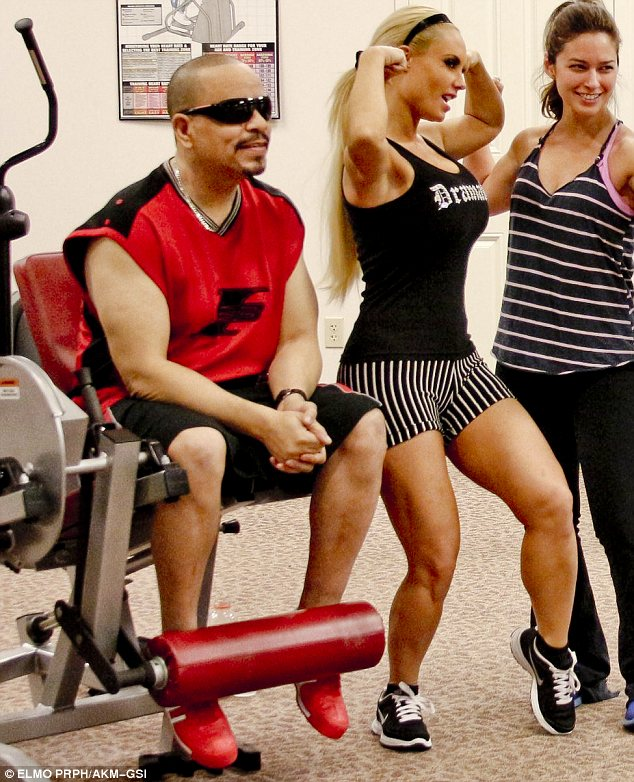 So macho: Coco flexed her muscles in skimpy gym gear as Ice-T did some weight training