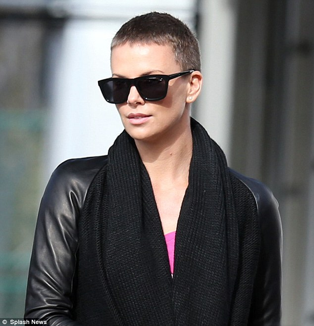 Still gorgeous: The Oscar winner, still growing out her salt-and-pepper buzzcut, made sure to walk arm-in-arm with her blonde mother for their sunny stroll
