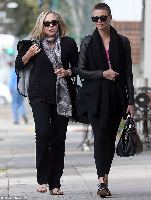 Painted ladies: Charlize Theron and her mother Gerda decided to get holiday pedicures at Zen Nail Spa in Beverly Hills Saturday
