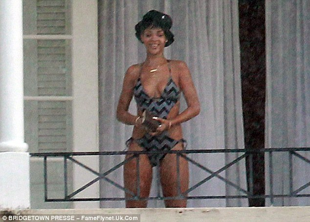 R&R: Rihanna looked like the holiday has been doing her some good and had a big smile on her face