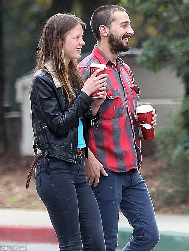Laid back: Make-up free Mia chuckled with her new beau as they strolled towards Descano Gardens in LA