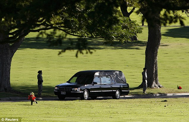 The hearse of Senator Inouye drives through the National Memorial Cemetery of the Pacific