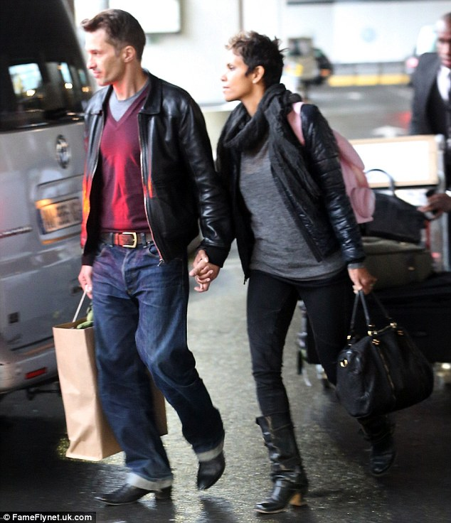 Joyeux Noel: The couple left their troubles in Los Angeles behind as they touched down in Paris
