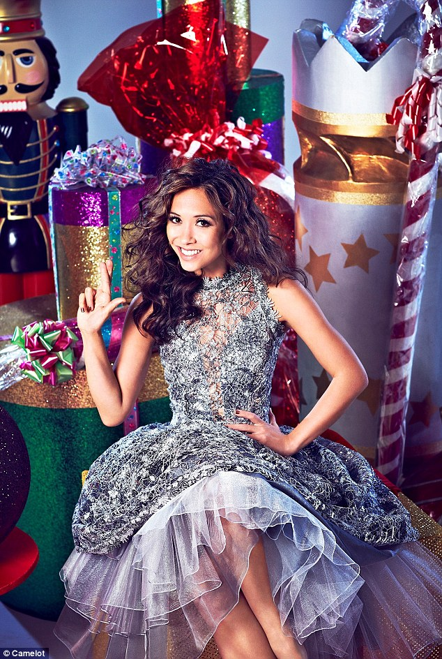 Looking good: Myleene was surrounded by Christmas presents as she kept her fingers and legs crossed