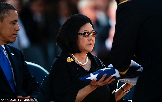 Last honor: Widow Irene Hirano Inouye recieves a folded flag that draped her husband's coffin