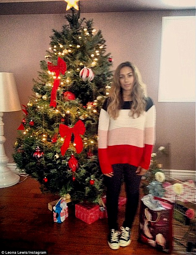 Giant tree: Leona Lewis poses with her enormous Christmas tree