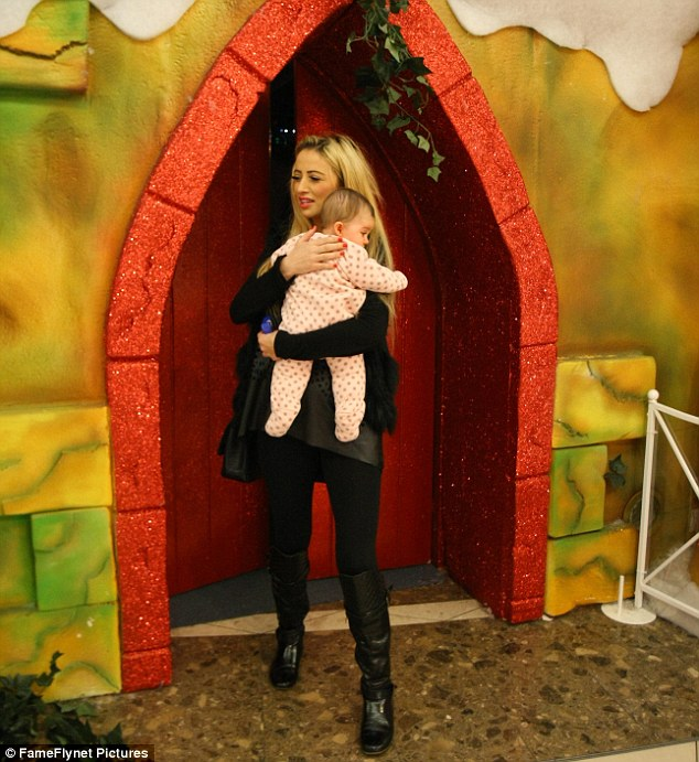Emotional: Chantelle is said to have burst into tears at the sight of Dolly sitting on Santa's lap, and held the little girl close as they headed out of the grotto