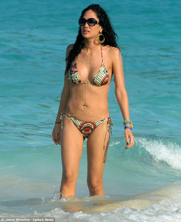 The ex: Kimora Lee Simmons takes a dip as she enjoys her family holida