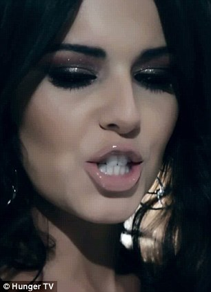 Sultry: Cheryl sports sexy eye make-up as she stares into the camera for the video
