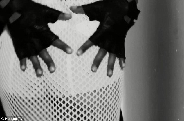 Hands on: Tre is also seen putting his hands on Cheryl's bottom as she shows off her figure in a white net skirt