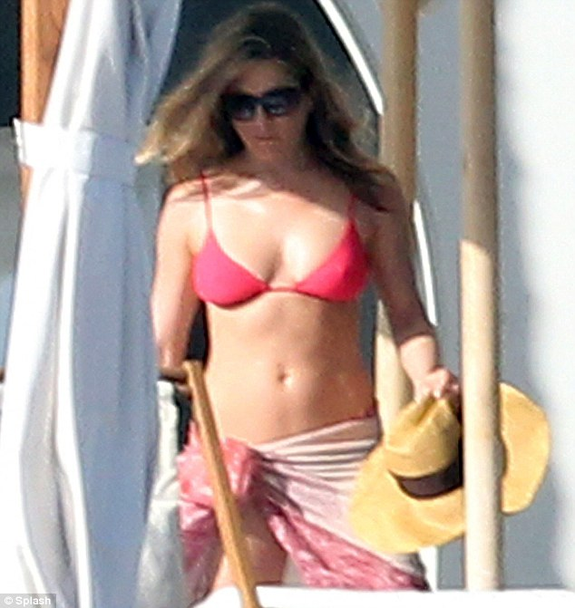 Bikini time! Jennifer Aniston spent Christmas Eve sunbathing in Cabo, Mexico