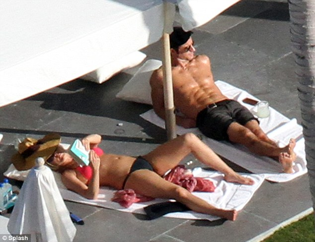 Tanning time! The pair relaxed in the sun