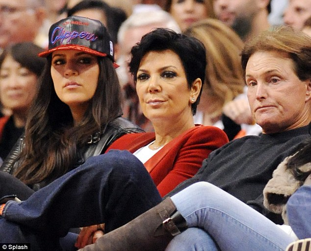 Seat warmer: Bruce Jenner sat beside his wife Kris and Khloe Kardashian at the LA Clipppers game on Christmas Day at the Staples Centre