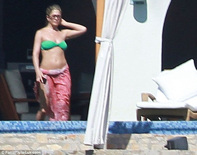 Fun in the sun: The actress also wore a green bikini during her stay