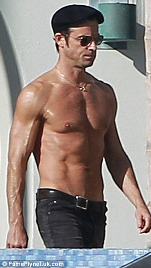 Buff bodies: Jennifer and her fiance Justin Theroux showed off their matching muscles