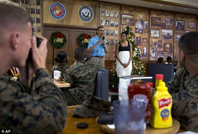 Keeper: Many of the Marines left with a souvenir photo of President and Mrs Obama