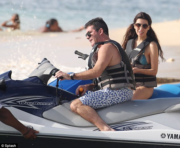 They're making a splash! Simon Cowell was seen enjoying a ride on a jet ski with his former fiancée Mezhgan Hussainy