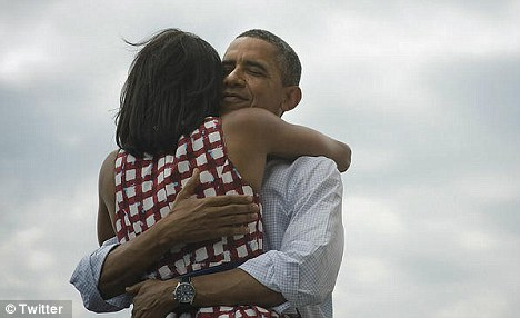 Real love: Michelle Obama said the embrace, which became the most shared photo in Twitter history, was a truly candid moment