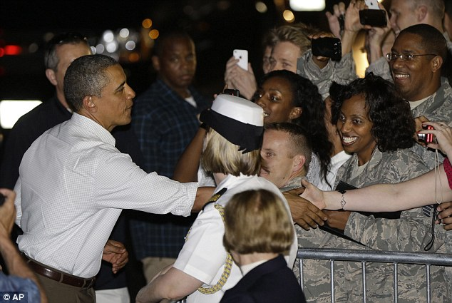 President Barack Obama greets base visitors and personnel before boarding Air Force One to return to Washington on December 26th from Hawaii