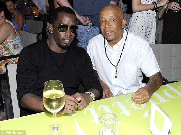 Mixing business with pleasure: Diddy fitted in a meal out with fellow hip hop supremo Russell Simmons