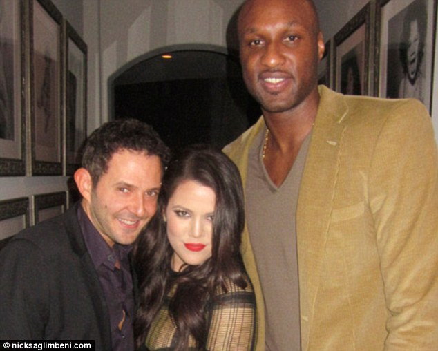 Home sweet home: 28-year-old Khloe also posed with her 33-year-old husband, who plays for the LA Clippers