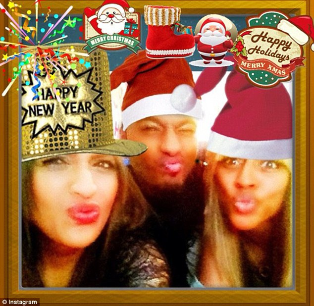 Festive fun: The singer shows her silly side as she poses with friends
