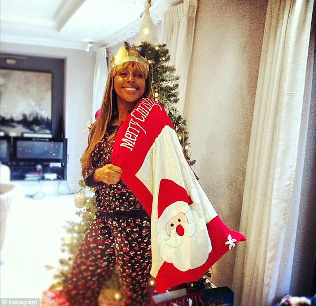 Christmas day: The star posted a picture of herself wearing a festive onesie and carrying a huge Santa sack