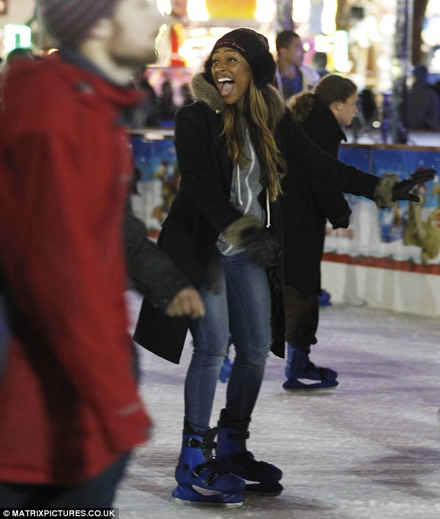 Having a laugh: The X Factor winner seems to be having a blast as she hits the ice with friends and family in tow