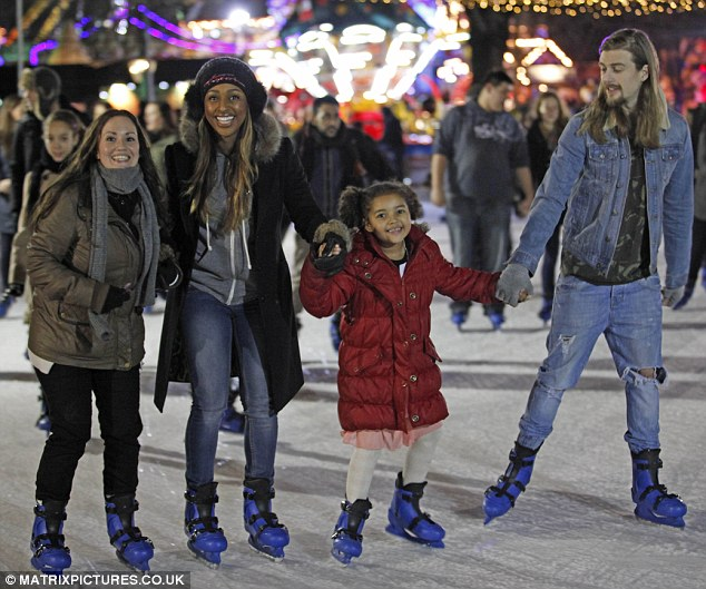 Family fun: Alexandra Burke takes to the ice with her family during a day out at Winter Wonderland on Thursday