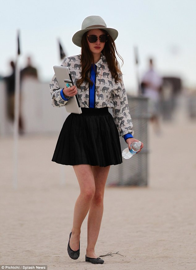 Chelsea girl: Stuck to her typical London girl style on the beach in Miami wearing a blouse, skirt, ballet pumps and fedora