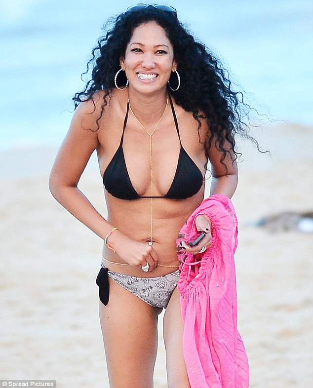 Belly laughs: Kimora Lee Simmons could not stop smiling as she enjoyed a day on the beach in St Barts on Friday